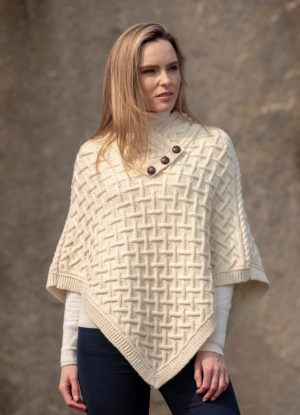 Colours Available Click Below: Charcoal, Brown, Green, Natural, Plum & Ink Blue Total Length: S/M 27″ M/L 29″ inches This beautiful Poncho is made using our new super soft merino wool. The Poncho is knit using the traditional Cable lattice pattern on the front and back of the poncho. The soft luxurious collar has the addition of 3 football buttons to allow the wearer to open or close for their own individual style.