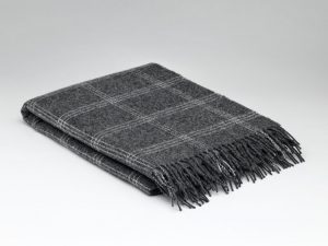 Description: Woven with 100% pure wool, this charcoal blanket has a cream window pane pattern running throughout . A beautiful blanket for a contemporary home. 'Nothing feels better' 100% Pure Wool
